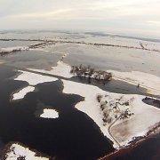 Spustelėjęs šaltukas neapsaugojo pamario nuo potvynio: tūkstančiai hektarų atsidūrė po vandeniu
