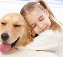 Terapija su šunimis: septynmetis gyvūnui tarė pirmą savo žodį
