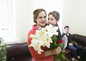 """Fotografė Akvilė Razauskienė pristatė parodą """"Mamos suknelė"""""""