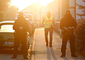Pareigūnai prie išpuolį įvykdžiusio siro namų