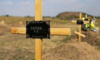 """""""Kareivis Nr. 9"""": kraupios teroristų kapinės prie Donecko – sunumeruoti kryžiai"""