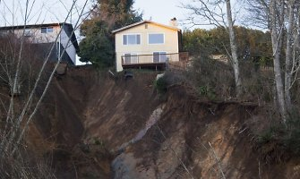 Vašingtono valstijoje stiprios liūtys sukėlė potvynius ir žemės nuošliaužas
