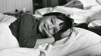 Nuotraukoje – žinoma gamtos fotografė, kai jai buvo šešeri: ar atpažįstate?