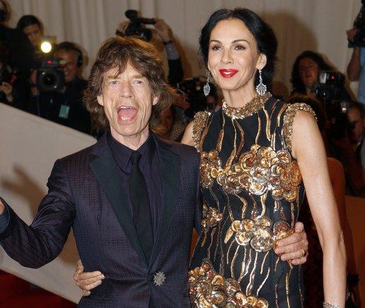 """""""Reuters""""/""""Scanpix"""" nuotr./Mickas Jaggeris ir L'Wren Scott (2011 m. gegužės 2 d.)"""