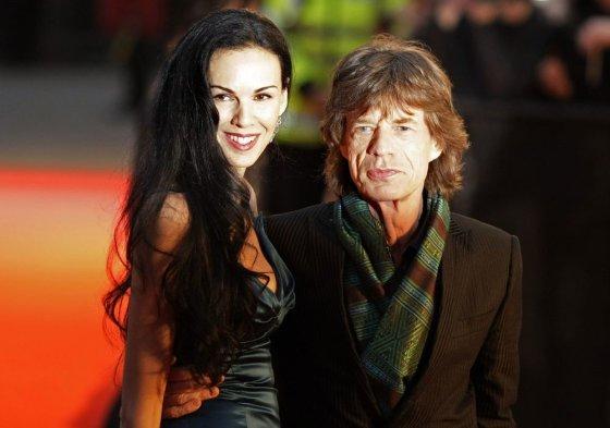 """AFP/""""Scanpix"""" nuotr./Mickas Jaggeris ir L'Wren Scott (2008 m. balandžio 2 d.)"""