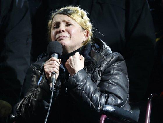 """""""Reuters""""/""""Scanpix"""" nuotr./J.Tymošenko paleista į laisvę."""