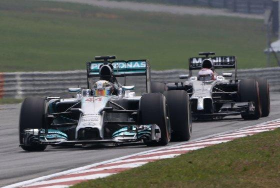 """""""Reuters""""/""""Scanpix"""" nuotr./Lewisas Hamiltonas ir Jensonas Buttonas"""
