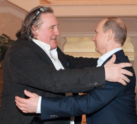 """AFP/""""Scanpix"""" nuotr./Prancūzijos aktorius Gerrardas Depardieu ir Rusijos prezidentas Vladimiras Putinas"""