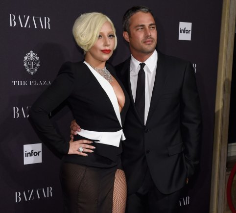 "AFP/""Scanpix"" nuotr./Lady Gaga ir Tayloras Kinney"