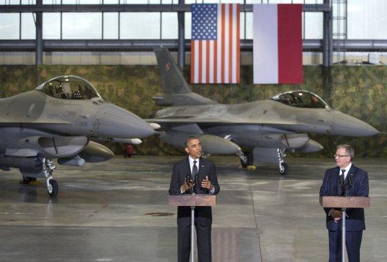 "AFP/""Scanpix"" nuotr./Barackas Obama ir Bronislawas Komorowskis"
