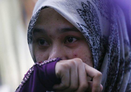"""Reuters""/""Scanpix"" nuotr./Žuvusio piloto Wano Amrano dukterėčia Abdul Rahman"