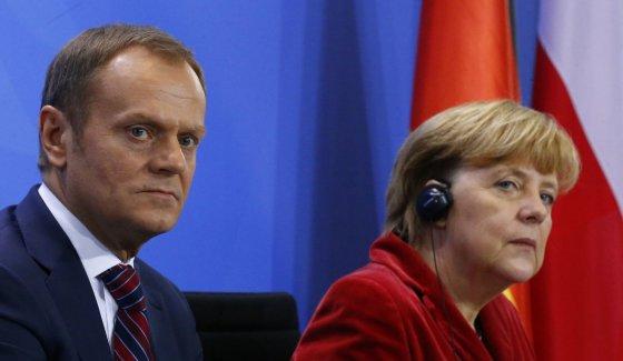 """Reuters""/""Scanpix"" nuotr./Donaldas Tuskas ir Angela Merkel"