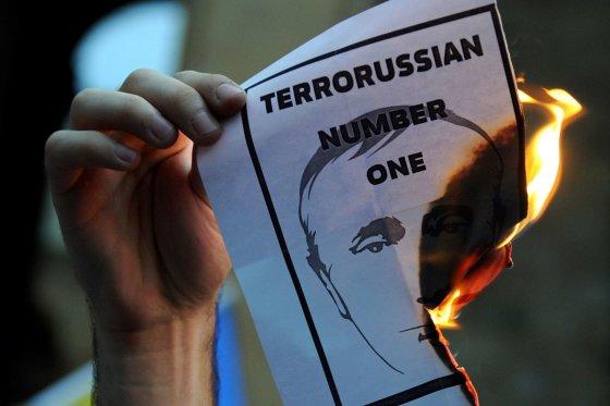 """AFP/""""Scanpix"""" nuotr./Protestas prieš V.Putiną"""