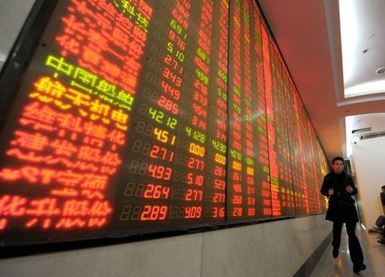 """AFP/""""Scanpix"""" nuotr./Investuotojas"""