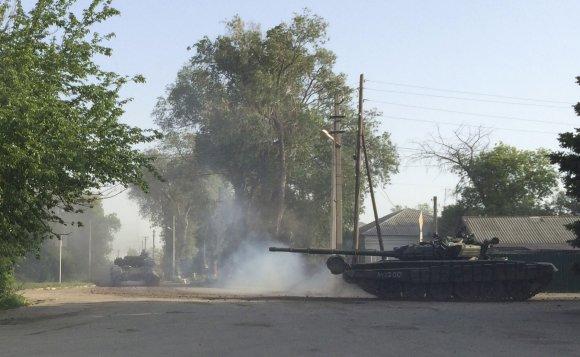 """""""Reuters""""/""""Scanpix"""" nuotr./Miesto gatvėmis važinėjantis tankas"""