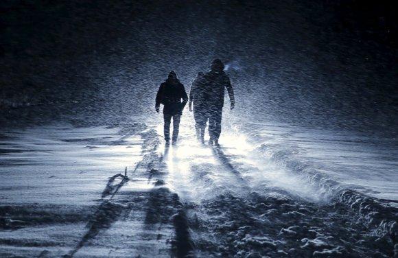 """""""Reuters""""/""""Scanpix"""" nuotr./Vyrai keliauja per pūgą Rusijoje"""