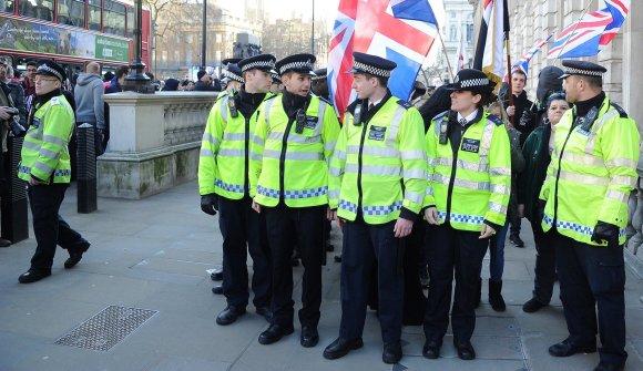 """""""Scanpix""""/Xposurephotos.com nuotr./Protestuotojus saugojo gausios policijos pajėgos."""